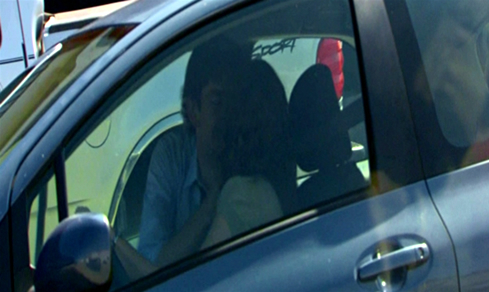 Jim and Pam kissing in car